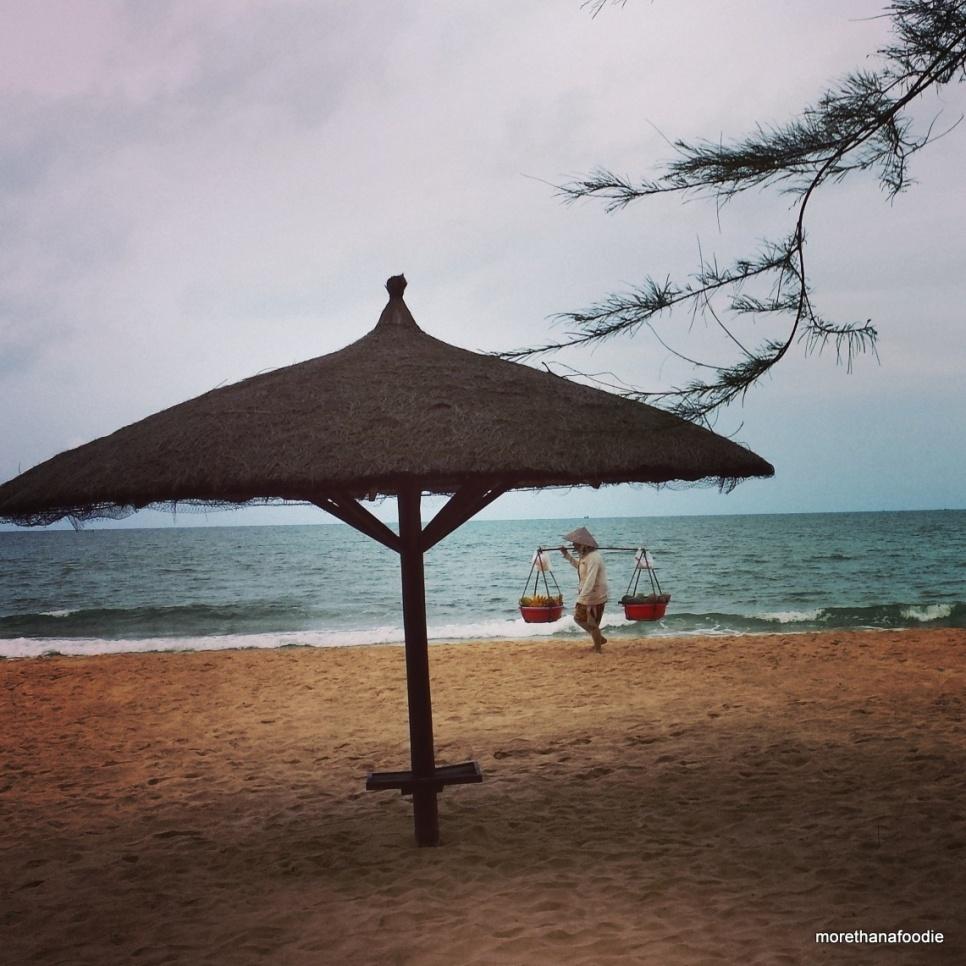 phu quoc beach fruit lady umbrella beach scene vietnam